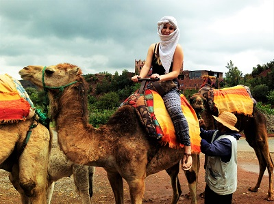 Smiling girl on camel in Marrakech