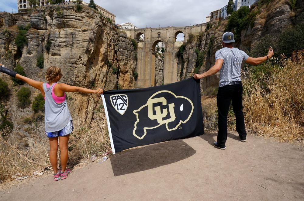 Students holding up CU flag in Spain
