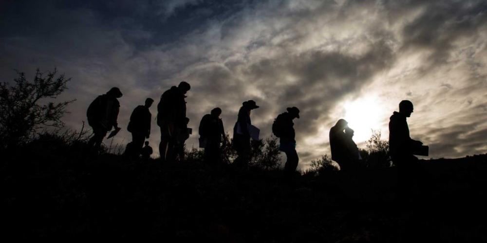Silhouettes of hiking students