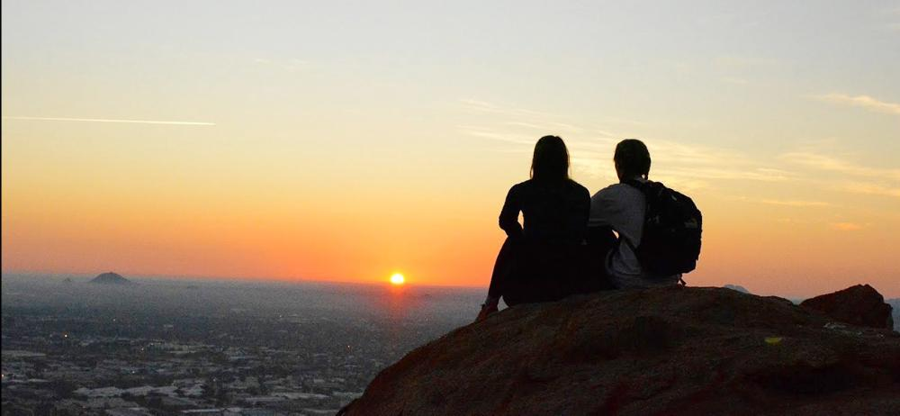 Students watch sunrise in Gaborone, Botswana