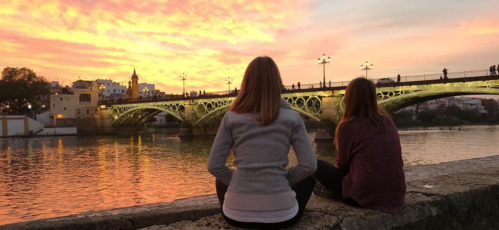 Students look at bridget at sunset in Seville, Spain by Madison Toretto