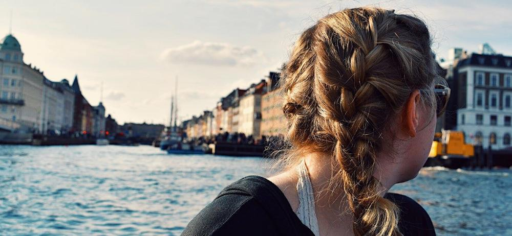 Student looking back on Copenhagen, Denmark by Caitlin Rose