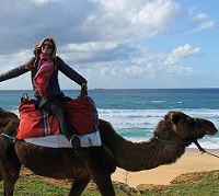 Student riding a camel in Morocco by Chloe Remington