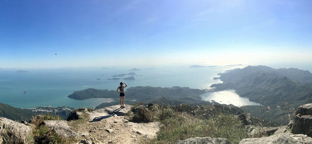 Student looking at view from trail running on Lantau Peak in Hong Kong by Samantha Lauckner