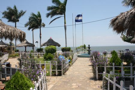 Managua Lakefront gardens and palm trees