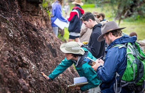 Students studying field geology in Australia by Brett Oliver