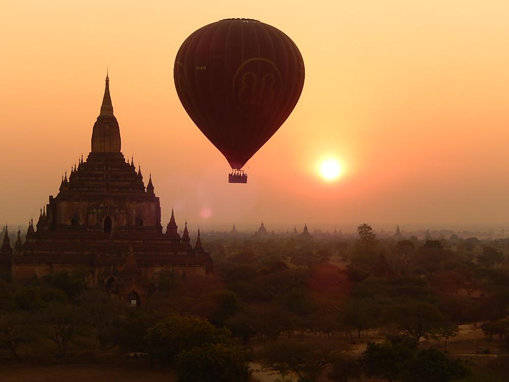 Hot air balloon over Myanmar temple by Nik Treece