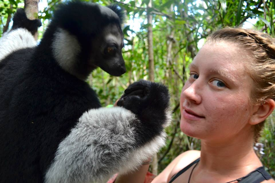 Student with lemur in Madagascar by Alison Shlom