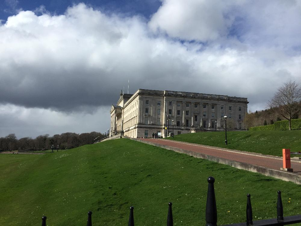 Stormont on grassy hill on a cloudy day