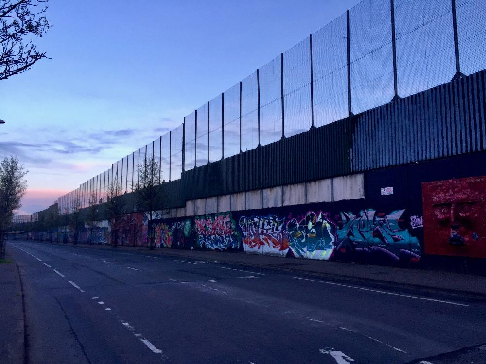 Graffitied wall at sunset