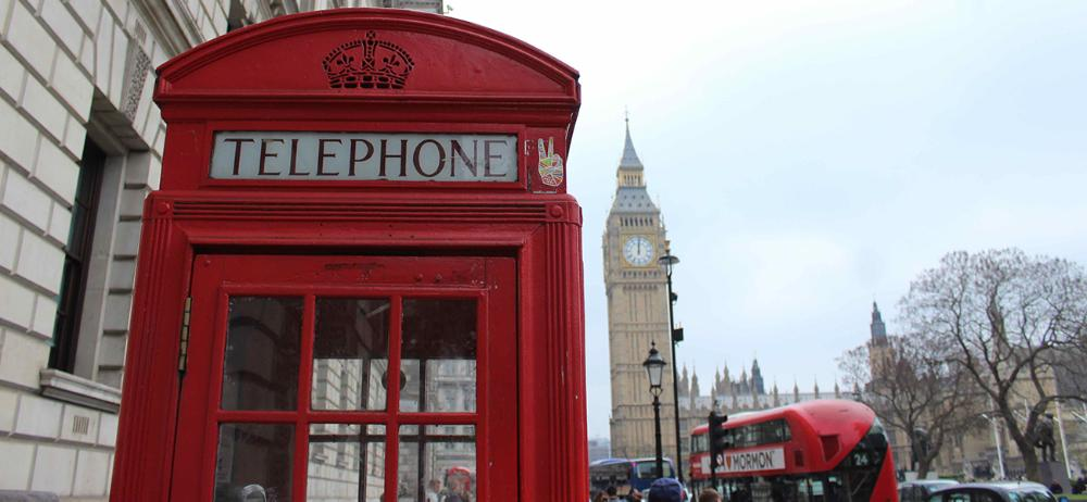 Big Ben, bus, and phone booth in London by Megan Boyles